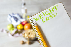 Notebook for weight loss plan and healthy diet food Royalty Free Stock Photography