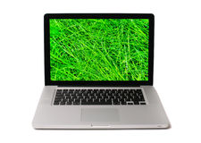 Notebook with wet grass on screen Stock Images