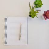 Notebook. A notebook on white background Royalty Free Stock Image