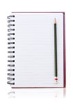 Notebook on the white with pencils. Royalty Free Stock Photo