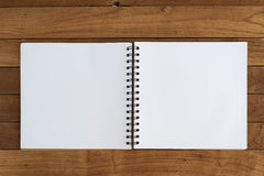 Notebook on white wood table .copy space Stock Photos