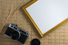 Notebook white on a wooden floor with a film camera. Notebook white on a wooden floor with a film camera and frame Royalty Free Stock Image