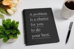 Notebook with wisdom quote and coffee cup. royalty free stock images