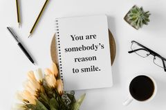 Notebook with wisdom quote and coffee cup. royalty free stock photography