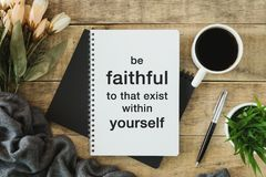 Notebook with wisdom quote. royalty free stock photo