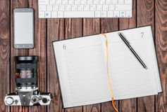 Notebook wit tablet on wooden table, Stock Image