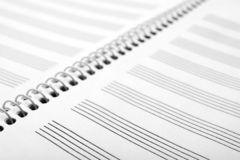 Notebook With Empty Staves For Music Notes As Background Stock Photography
