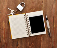 Notebook With Old Photo And Lock And Key Royalty Free Stock Photos