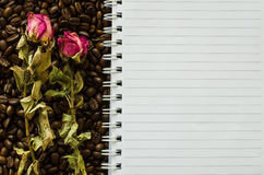 Notebook and wizened rose Royalty Free Stock Image