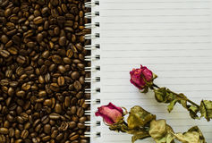 Notebook and wizened rose Stock Photography