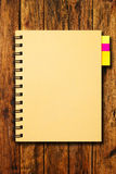 Notebook on wood background Royalty Free Stock Photo