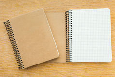 Notebook on wood background Royalty Free Stock Images