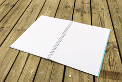Notebook on wood Stock Image