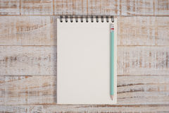 Notebook on wood table and background Stock Photography