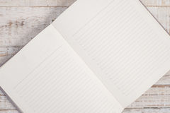 Notebook on wood table for text and background Royalty Free Stock Photography