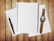 Notebook on wood table for text and background Stock Photography