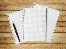 Notebook on wood table for text and background Royalty Free Stock Images