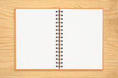 Notebook on wood table Royalty Free Stock Image