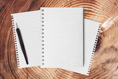 Notebook on wood table for text and background Royalty Free Stock Photo