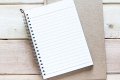 Notebook on wood table Stock Image