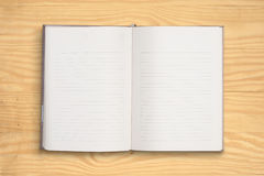 Notebook on wood table for work and public relation Stock Images