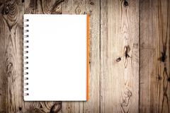 Notebook on wooden background Royalty Free Stock Image