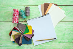 Notebook on wooden background Stock Images