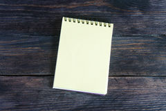 Notebook on a wooden background Stock Images
