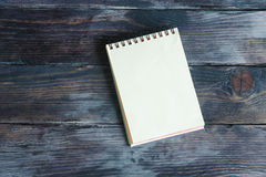 Notebook on a wooden background Stock Photo