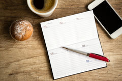 Notebook on wooden desk Royalty Free Stock Photo