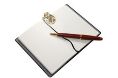 Notebook with wooden pen and gold bookmark Royalty Free Stock Images