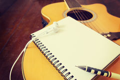 Notebook and wooden pencil on guitar Stock Photo