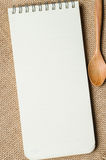 Notebook and wooden spoon Stock Photo