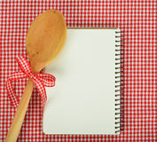 Notebook and wooden spoon Stock Image