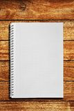 Notebook on wooden table Royalty Free Stock Photo