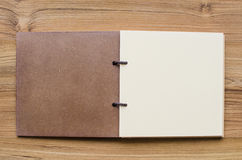 Notebook on wooden table Royalty Free Stock Images