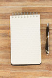Notebook on wooden table Stock Image