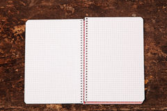 Notebook on the wooden table Stock Images