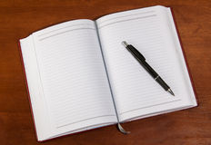 Notebook on a wooden table Stock Photography