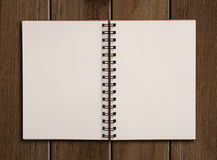 Notebook on wooden table. Royalty Free Stock Images