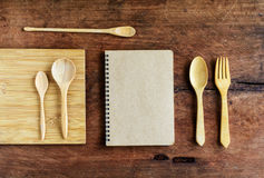Notebook and wooden utensil on old wood Royalty Free Stock Photography