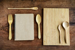 Notebook and wooden utensil on old wood Stock Images