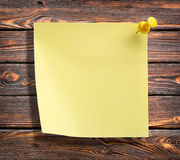 Notebook on a wooden wall Royalty Free Stock Photo