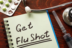 Notebook with the words Get Flu shot. Royalty Free Stock Photo