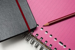 Notebook and workbook with red pencil Stock Images
