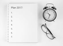 Notebook for working notes, watches, sunglasses. Plan 2017. Tools for the business person Royalty Free Stock Photo