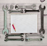 Notebook and wrench Royalty Free Stock Photo