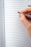 Notebook writing Stock Photo