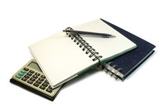 Notebook and calculator. Pen on notebook and calculator Stock Image