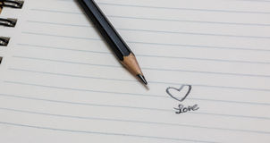 Notebook. Written love and heart in notebook Royalty Free Stock Photography